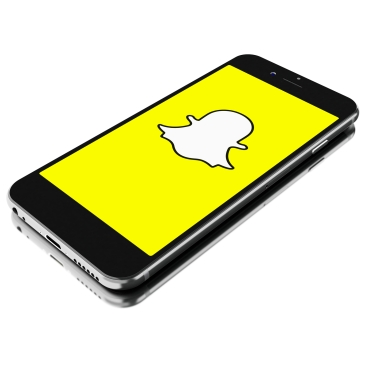 BUENOS AIRES, ARGENTINA - SEPTEMBER 07,2016: 3d renderer image. Smartphone with Snapchat logo on the screen. Snapchat is popular a photo messaging application. isolated white background