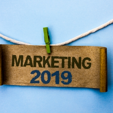 Handwriting text Marketing 2019. Concept meaning New Year Market Strategies Fresh start Advertising Ideas written Cardboard Paper hanging on rope the plain background Clip.